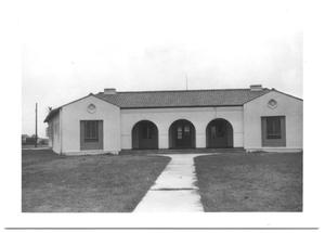 Primary view of object titled '[Front Entrance to a Building with Arches]'.
