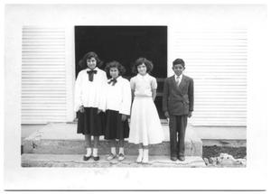 Primary view of object titled '[Four Hispanic Children Dressed Formally]'.