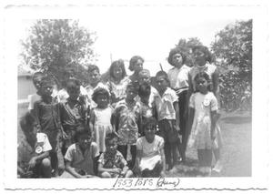Primary view of object titled '[Group of Children in a Grassy Field]'.