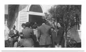 Primary view of object titled '[Group of People Visiting in Front of a Church]'.