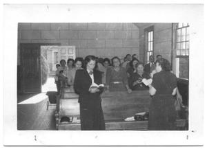 Primary view of object titled '[Congregation of Women Singing]'.