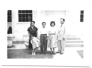 Primary view of object titled '[Family Standing in Front of an Entrance]'.