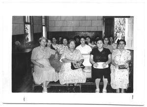 Hispanic Women Sitting in Church Pews