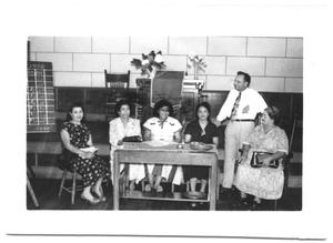 Primary view of object titled '[Group of Hispanic Women Sitting at a Table]'.