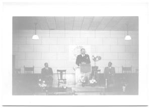 Primary view of object titled '[Reverend Standing Behind a Podium]'.