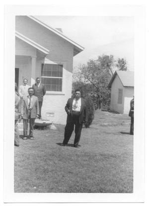 Primary view of object titled '[Reverend Standing in Front of a Church]'.