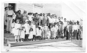 Primary view of object titled '[Large Group of Hispanic Workers and Children]'.