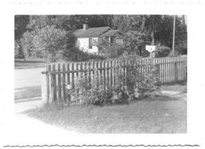 Primary view of object titled '[Wooden Fence by a Street]'.