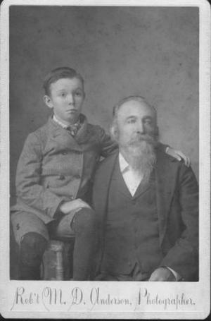 Primary view of object titled '[Man with gray beard posing with boy]'.