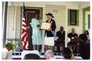 Ernestine Thompson receiving community service award from D.A.R.