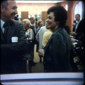 Primary view of object titled '[Audrey Kariel and Truitt at a Library Gathering]'.