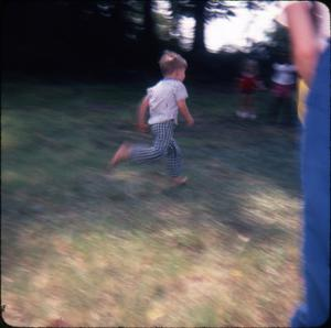 Primary view of object titled '[Child Races at the Picnic]'.