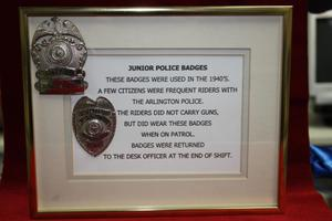Primary view of object titled '[Image of frame containing Junior Police Badges with description]'.