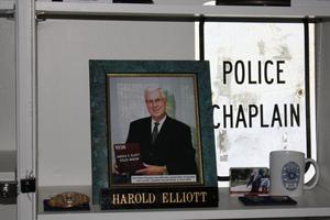 Primary view of object titled '[Image of items recognizing Chaplain Harold Elliott, founder of the Arlington Police Museum]'.