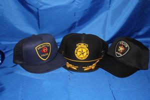 [Image of three baseball caps made for the Arlington Police Department]