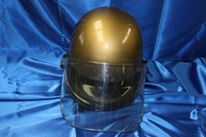 Primary view of object titled '[Image of an APD helmet with face shield]'.