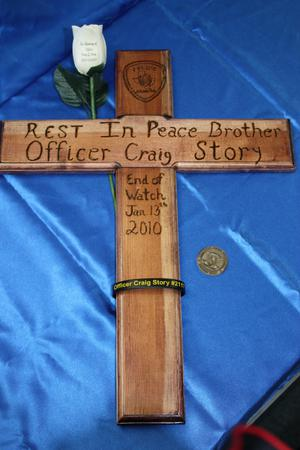 Primary view of object titled '[Image of a wooden cross made in memory of Police Officer Craig G. Story]'.