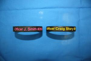 Primary view of object titled '[Image of two wrist bands honoring Officer Jillian Smith and Officer Craig Story]'.