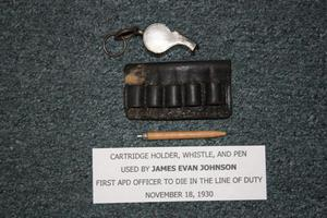 Primary view of object titled '[Image of Arlington Police Officer James E. Johnson's cartridge holder, whistle, and pen]'.