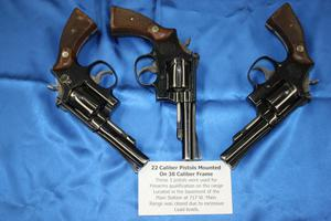 Primary view of object titled '[Image of three pistols used for APD firearms training, 1950s-1970s]'.