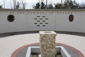 "Primary view of object titled '[Heroes' Park ""We Remember Wall"" and ""Remembrance Courtyard"", view 2]'."