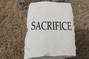 "Primary view of object titled '[Heroes' Park ""Sacrifice"" character trait of a hero stone]'."