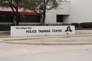 Primary view of object titled '[Police Training Center building entrance sign]'.