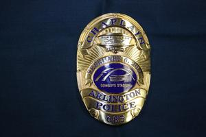 Primary view of object titled '[Image of an APD Chaplain Super Bowl badge, 2011]'.