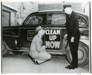 "Primary view of object titled '[Arlington Police Commissioner Joe Elder and Fire Chief Mike Thompson, 1948, ""Clean Up Now"" campaign, date on photo]'."