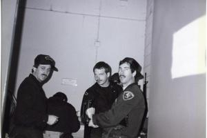 Primary view of object titled '[APD officers following tactical response, 1984]'.
