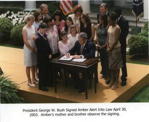 [AMBER Alert : President George W. Bush signs the AMBER Alert into law]