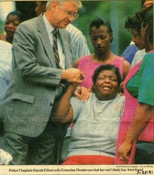 Primary view of object titled '[Arlington Police Chaplain Harold Elliott comforting Ernestine Henderson, newspaper clipping, 1991]'.