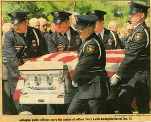 Primary view of object titled '[Arlington Police Officer Terry Lewis's casket carried by the Honor Guard during his funeral, newspaper clipping, 1992]'.