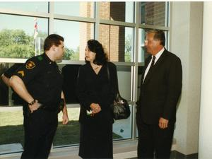 Primary view of object titled '[Arlington Police Officer Chip Oxendine with his parents]'.