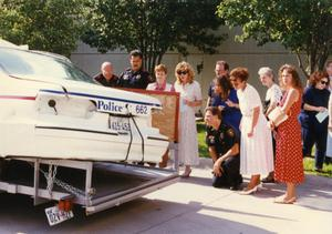 Primary view of object titled '[Arlington patrol car belonging to Officers Lewis and Crocker on display for MADD, 1992, back view]'.