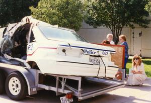 Primary view of object titled '[Arlington patrol car belonging to Officers Lewis and Crocker on display for MADD, 1992, back side view]'.