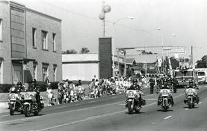 Primary view of object titled '[APD Motorcycle Division in a Fourth of July parade, late 1980s]'.