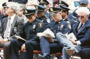 [Arlington Police Chief David Kunkle with Fort Worth Police Chief Tom Windham at a Fort Worth memorial service]