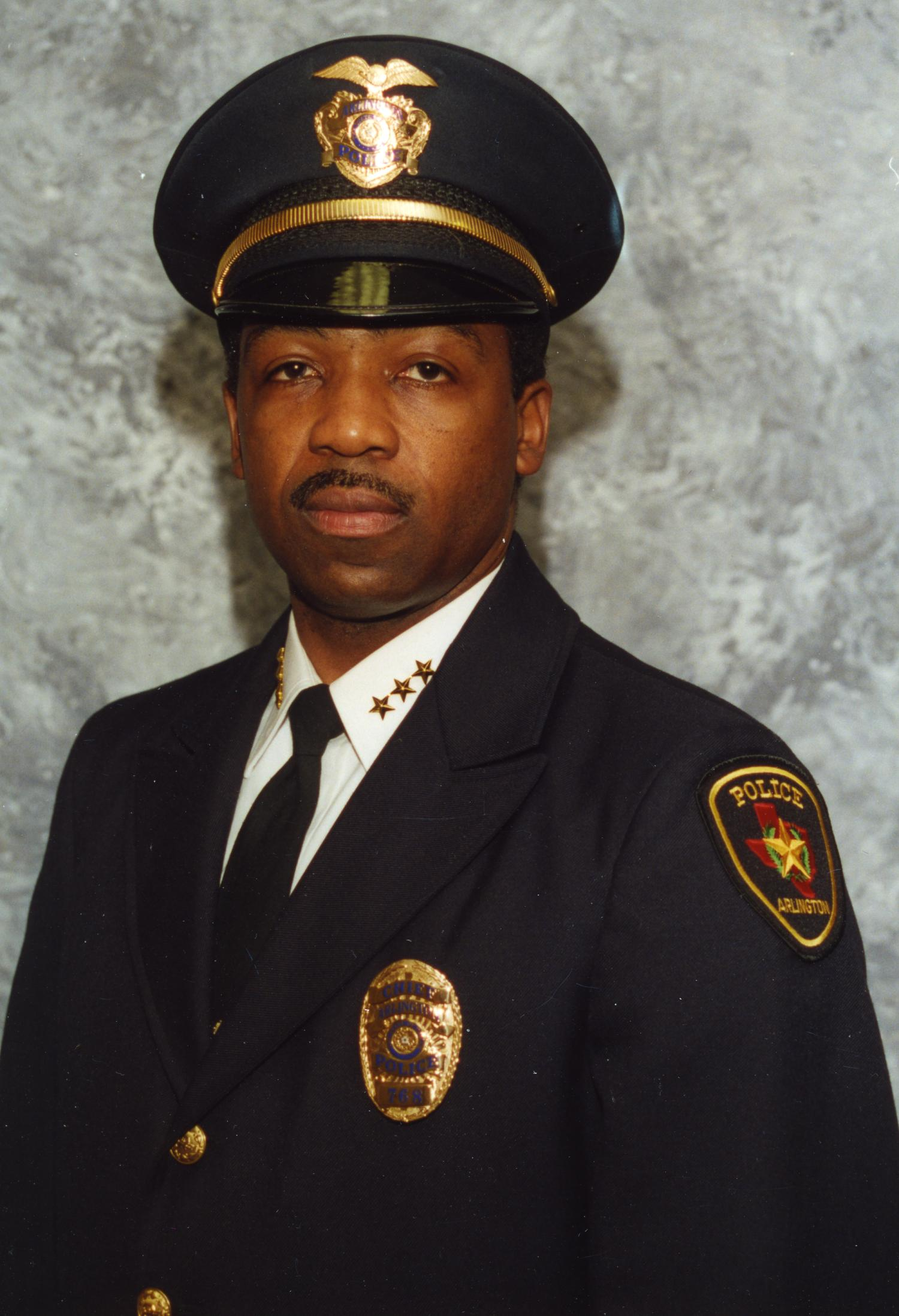 [Arlington Police Chief Theron Bowman, portrait with hat on head]                                                                                                      [Sequence #]: 1 of 1