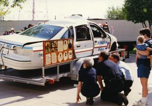 Primary view of object titled '[Arlington patrol car belonging to Officers Lewis and Crocker on display for MADD, 1992, passenger side view]'.