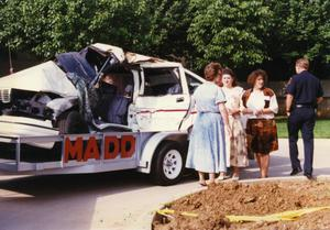 Primary view of object titled '[Arlington patrol car belonging to Officers Lewis and Crocker on display for MADD, 1992, driver side view]'.