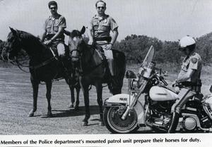 Primary view of object titled '[APD Mounted Patrol police with motorcycle policeman, ca. 1986]'.