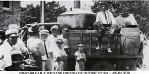 "Primary view of object titled '[Arlington Constable A. B. Austin with moonshine still he ""busted"" in 1932]'."