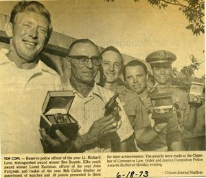 Primary view of object titled '[Newspaper clipping about Arlington Police Officers receiving awards, 1973]'.