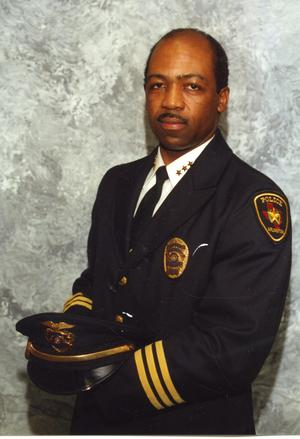 [Arlington Police Chief Theron Bowman, portrait with hat in hands]