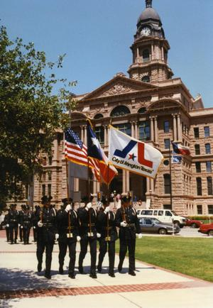 "Primary view of object titled '[APD Honor Guard ""Color Guard"" in front of Tarrant County Courthouse]'."