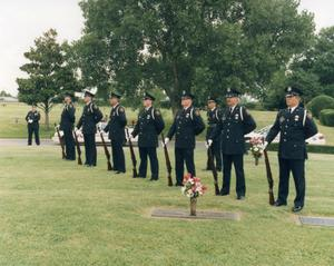 Primary view of object titled '[APD Honor Guard Rifle team at a memorial service]'.