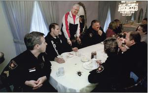 Primary view of object titled '[Arlington Police Chaplain Harold Elliott's annual New Year's Day Police Breakfast, 2002]'.