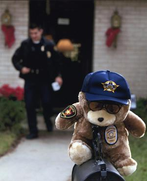 "Primary view of object titled '[Arlington Police Chaplain Harold Elliott's ""Cop Bear"" on his mailbox]'."