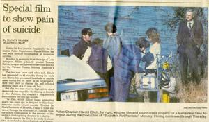 "Primary view of object titled '[Arlington Police Chaplain Harold Elliott's film ""Suicide is not painless"" newspaper article from the Arlington Daily News, 1986]'."